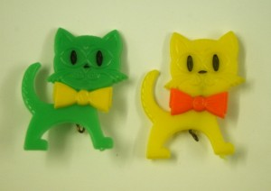 East German cat brooches